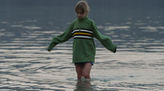 Medium shot of girl wading in lake / Redfish Lake, Idaho, United States Stock Footage