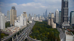 long heavy traffic on highway,Shanghai business building skyscraper skyline. - stock footage