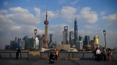 Shanghai Lujiazui financial center,Tourists play in huangpu river bund. - stock footage