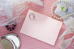 blank pink card for congratulations with  ring. - stock photo