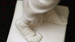 An arbitrary human sculpture Stock Footage