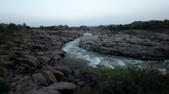 Panorama- rough rapids in rocky river in Hampi, India and white birds flying - stock footage