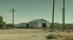 Abandoned Steel Industrial Building Along Train Tracks Stock Footage