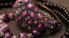 Various jewellery on the table Stock Footage