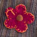 Stock Photo of ornamental flower stitched onto fabric