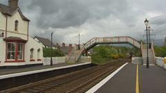 Regional railway train stops at Llanfairpwllgwyngyll railway station Stock Footage