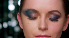 Glamour Lady With Artistic Dark and Colorful Makeup on Eyes Stock Footage