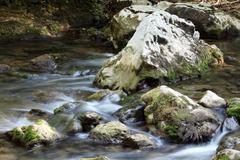 rocks and creek water spring season - stock photo