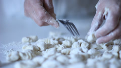 Gnocchi Pasta being rolled over a fork Stock Footage