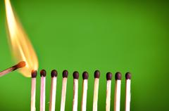 concept with matches- chain reaction - stock photo