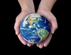 Man holding a globe in his hands. elements of this image furnished by nasa Stock Illustration