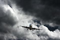 passenger plane on final approach - stock photo