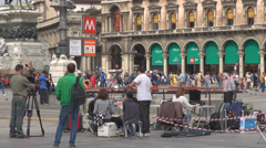 Production crew film actor operator camera technology cameraman duomo square day Stock Footage