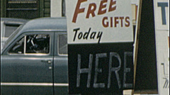 GAS WAR! FREE GIFTS! TV SAMPLE Product Sign 1960s Vintage Film Home Movie 7530 Stock Footage