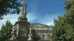 Leonardo Da Vinci's statue Piazza della Scala opera house tree leaf sculpture  Stock Footage
