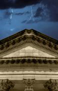 lighning strikes over banking institution - stock photo