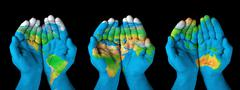 map painted on hands.concept of having the world in our hands - stock illustration