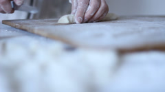 Nyoki Gnocchi Pasta being rolled over a fork Stock Footage