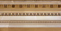 intricate sandstone cornice work - stock photo