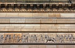 Intricate mouldings on old sandstone building Stock Photos
