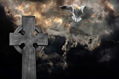Graveyard cross with seagull against storm clouds Piirros