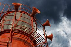 bright red lighthouse with fog horns on white background - stock photo