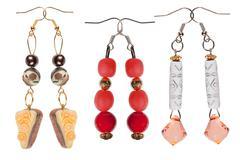 Earrings-pendants handmade on white background Stock Photos