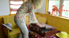 Woman girl fill suitcase trunk portmanteau with summer clothes Stock Footage