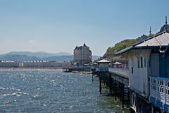 llandudno pier in wales uk, on a bright sunny day - stock photo
