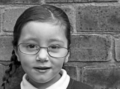young girl wearing glasses - stock photo