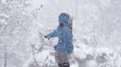 Slow-Mo: Young Woman Spinning On Snowy Winter Day In Park Stock Footage