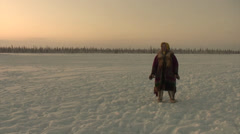 Mansi woman watching a herd of reindeer Stock Footage
