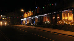 houses with christmas lights traffic bus two people - stock footage