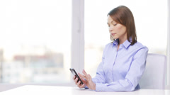 busy businesswoman with smartphone in office - stock footage