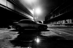 Street at night in black and white - stock photo