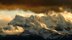 Mountains and snow clouds - time lapse Stock Footage