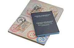 uk passport with turkish visitor visa's and residence permit - stock photo