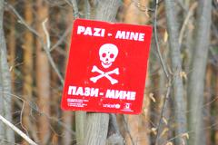 warning sign on mined area - stock photo