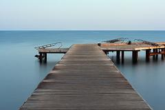 long exposure on wooden pier at dawn - stock photo