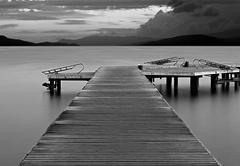 Stock Photo of long exposure on wooden pier at dawn