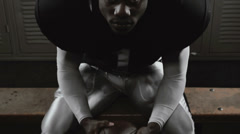 A football player rises from his bench in preparation for the game. - stock footage