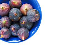 Bowl of ripe figs isolated on white Stock Photos
