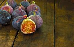 Stock Photo of ripe figs on rustic wooden table