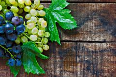 Stock Photo of assortment of grapes on a rustic wooden table