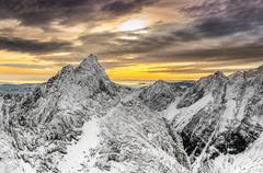scenic view of winter mountains and colorful sunset - stock photo