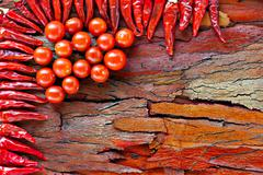 Stock Photo of chilli and tomato on rustic background