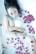 sexy woman enjoying her milk bath - stock photo