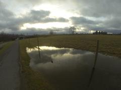 Sun reflecting off puddle - stock photo