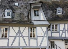 grey and white half-timbered house - stock photo
