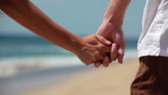 Stock Video Footage of Couple on Hawaiian beach hold hands and walk away from the camera